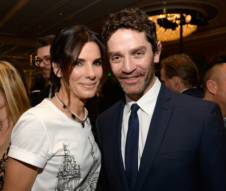 BEVERLY HILLS, CA - JANUARY 11:  Actress Sandra Bullock (L) and actor James Frain attend the BAFTA LA 2014 Awards Season Tea Party at the Four Seasons Hotel Los Angeles at Beverly Hills on January 11, 2014 in Beverly Hills, California.  (Photo by Kevork Djansezian/BAFTA LA/Getty Images for BAFTA LA)